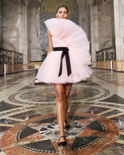 model wearing pink short dress tulle gown
