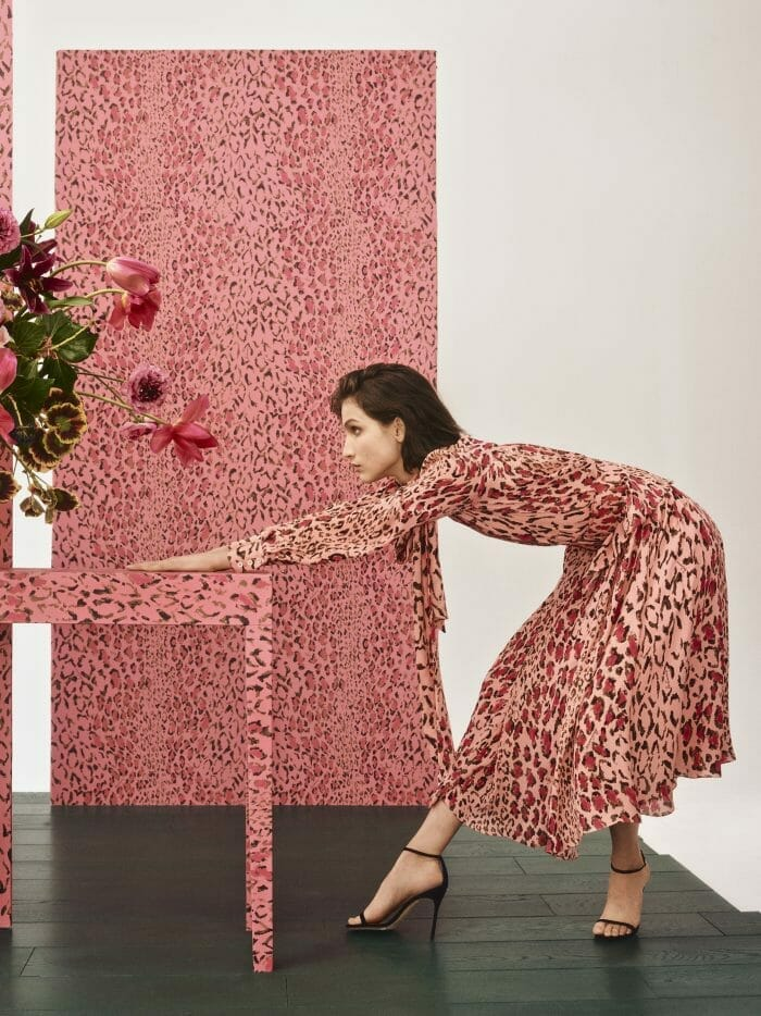 carolina herrera new york model wearing pink leopard dress