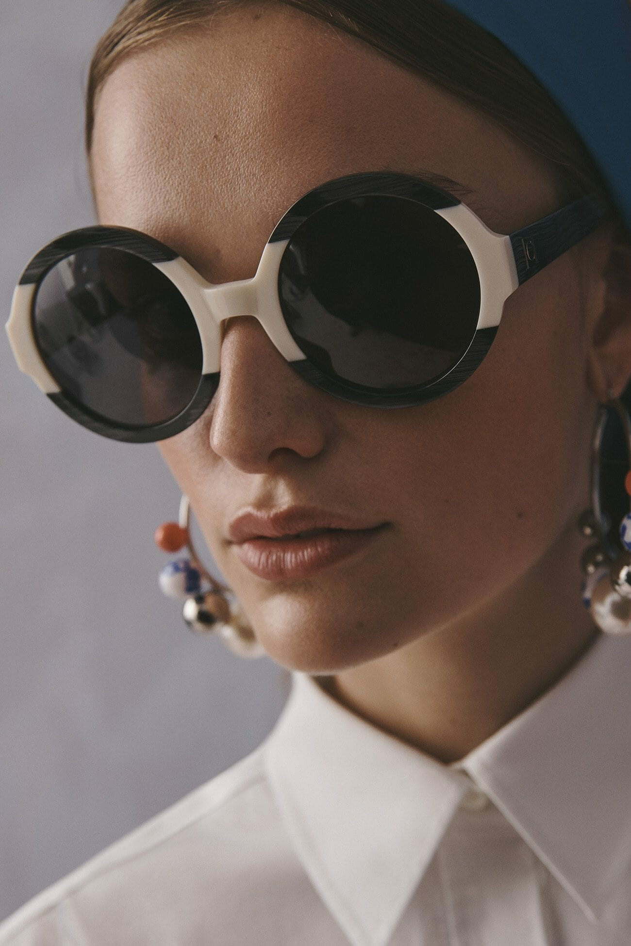 Carolina Herrera New York Resort 2020 Collection white shirt sunglasses model