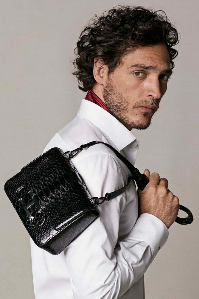 CH Carolina Herrera. New menswear collection Autumn Tales, featured with Initials Insignia bag. Look 05
